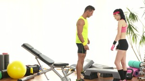 Young caucasian couple fitness at the gym in HD