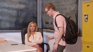 Nina Elle wearing glasses goes wild on cock in school
