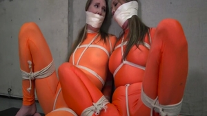 Charming girl in spandex erotic tied up