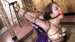Extreme hogtied along with brunette