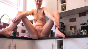 Amazing housewife rubbing in the kitchen in HD
