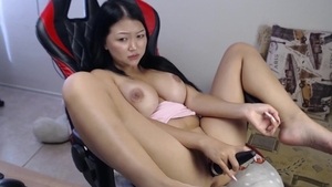 Squirt accompanied by big tits asian brunette